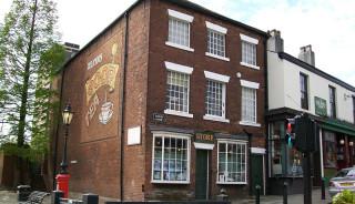 ロッチデール先駆者協同組合の最初の店舗が入居していた建物(出典: Wikipedia)