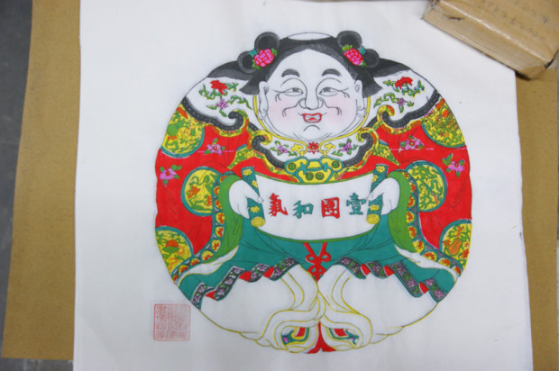 桃花塢年画の代表的な図柄、「一団和気」